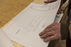 On Thursday, January 4, 2018, Double Edge Theatre facilities and operations director Michael Fitzgerald looks over plans for the proposed kitchen which will adjoin the existing shop.