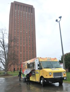 People line up at the Baby Berk food truck on the UMass campus.