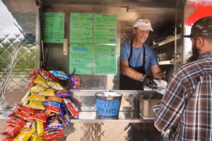 JERREY ROBERTS Mike Foley, owner of Foley's Franks, works in his food trailer Tuesday, May 26, on Mount Tom Road (Rte. 5) in Northampton.